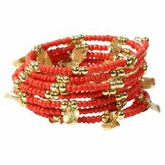 """A bold anchor for bright ensembles and neutral outfits alike, this coiled bracelet showcases gold-tone brass flakes and coral-hued beads.    Product: BraceletConstruction Material: Resin and brassColor: CoralFeatures: Stretches to fit mostDimensions: 0.75"""" H"""