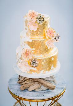 gold foil cake, photo by Jenna Saint Martin http://ruffledblog.com/driftwood-wedding-inspiration #weddingcake #cakes