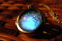 Glow In The Dark Glass Orb Galaxy Necklace. $30.00, via Etsy.