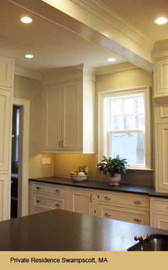 recessed lighting in the ceiling and under cabinet lighting to illuminate countertops