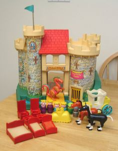 Fisher Price Castle - I loved playing with this castle and, thanks to my mom, my daughter will get to enjoy it too! :)