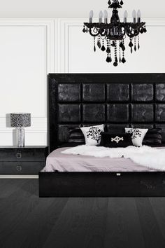 What a glamourous room! Instantly chic up your room with this sophisticated upholstered black crocodile textured bed frame!