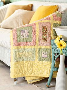 Quick Spring-Inspired Quilt-Simple squares and rectangles combine with sashing to create a quick quilt for baby in springtime pastels