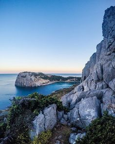Hike up to overlook Anthony Quinn Bay during sunset. We love Greece.