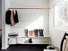 A simple copper pipe does the trick when it come's to hanging clothes.