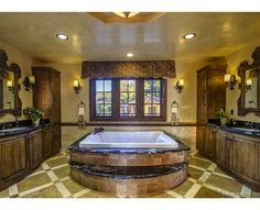 I would love to have a huge tub like this in my master bath!!! I like the cabinet idea also seating bench on tub