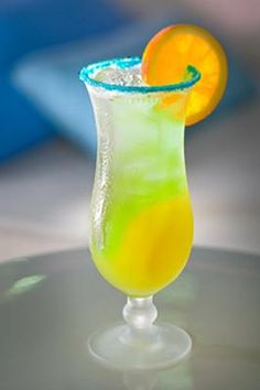 Aruba Arriba ~ 1 oz. white rum, 1 oz. vodka, 1/4-oz. banana liqueur, 3 oz. fruit punch, 1/4-oz. orange Curaçao liqueur---Mix the rum, vodka, banana liqueur and fruit punch in a shaker and serve over ice, then top off with the orange Curaçao liqueur.