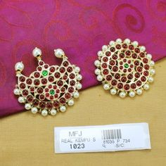 http://www.bharatjewel.com/bharatanatyam-jewelry/6435-high-quality-kempu-stones-traditional-design-sun-moon-temple-sun-moon-dance-jewellery-buy-online.html