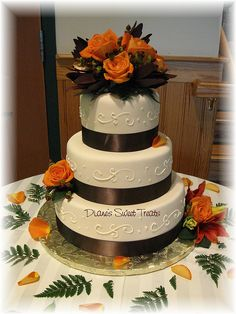 Fall wedding cake with brown ribbons