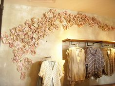 Make these sewing pattern tissue flowers with a simple DIY tutorial with photos for each style flower. Display them on a wall like Anthropologie in a whimsical pattern. Tissue Flowers, Paper Flowers, Flower Wall Decor, Wall Art Decor, Book Page Flowers, Store Displays, Window Displays, Visual Display, Store Design