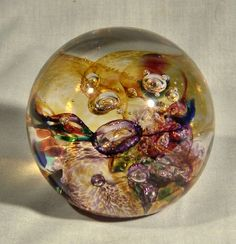 images of White Elk's paperweights | Paperweight - Held Glass - Amethyst and Amber