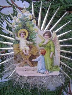 A rarity indeed is this large nativity starburst ornament crafted from all antique materials. These truly beautiful German scraps are extremely