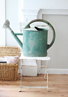 Love old watering cans and the color of this one is fabulous!
