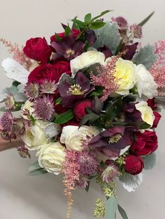 Rich in jewel tones this bouquet is sure to put a smile on any brides face.