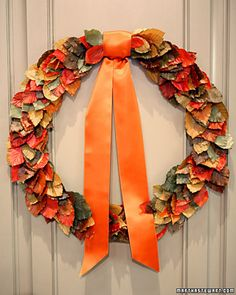 Autumn Leaf Wreath. It says to use leaves treated with glycerin, but you can just dip leaves in wax and use those.