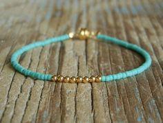 Delicate Tiny Matt Opaque Turquoise & Small Gold Beaded Friendship Bracelet. $10.00, via Etsy.
