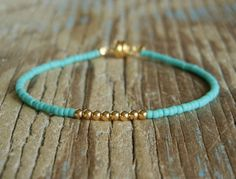 Delicate Tiny Matt Opaque Turquoise & Small Gold Beaded Friendship Bracelet. $10.00, via Etsy.