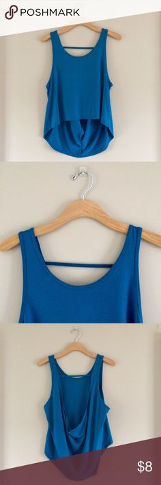 Onzie open back tank Blue trapeze style tank. Cropped in the front, long in the back with an open back. Scoop neck. A little bigger than an inch wide straps. Cute active wear top.   Used but still great condition. No stains or pilling   80% nylon 20% spandex Onzie Tops Tank Tops