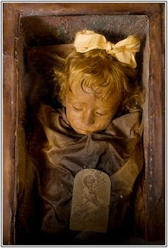 "She's one of the world's best-preserved bodies: Rosalia Lombardo, a two-year-old Sicilian girl who died of pneumonia in 1920. ""Sleeping Beauty,"" as she's known, appears to be merely dozing beneath the glass front of her coffin in the Capuchin Catacombs of Palermo, Italy."