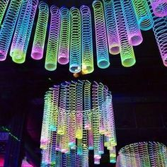 Slinkies definitely made a comeback at our event - Diy Event Glow In Dark Party, Glow Stick Party, Glow Sticks, Black Light Party Ideas, 18th Birthday Party, Birthday Party Themes, Teen Party Themes, Disco Theme Parties, Prom Themes