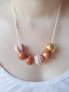 Sand Dollar: Ceramic Bead Necklace. $70.00, via Etsy.