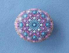 Hand painted Mandala Stone using acrylic paint and protected with Matt varnish...