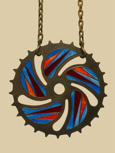 Sprocket stained glass pinwheel.  22 inch vintage design cut from a steel saw blade.