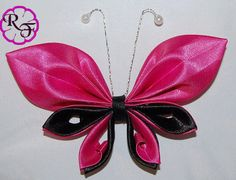 __This listing is for a very cute Kanzashi butterfly made of satin ribbon __Beautiful pink and black colors  __Is 4. long and attached to a 2 long