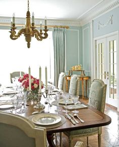 Gorgeous...We're big on the vintage French chandeliers! This is such an elegant dining room in the  Beautiful Dining Rooms feature by Traditional Home®