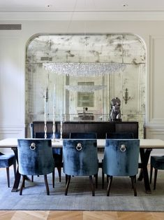 Beautiful Eglomise Mirror and Reflection of Chandelier  Contemporary Antique Luxury Colour of Dining Chairs  Handle at the back of Dining Chairs