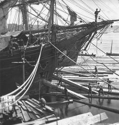 Loading ship with square timber through the bow port, Quebec City, QC, 1872 | by Musée McCord Museum