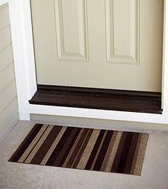 """Alfombra de entrada """"Come In"""" Felpudo. Composición 100% vinílica. 45x75cm. Color franjas Moka: Amazon.es: Hogar. 22,99€."""