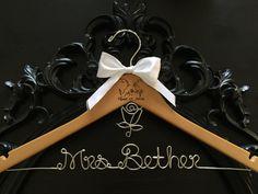 A personal favorite from my Etsy shop https://www.etsy.com/listing/234541884/disney-wedding-disney-bride-hanger