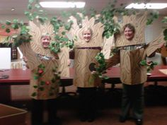 Tree Costumes - Made from scrap cardboard and hot glued silk leaves to the branches and brown paint swirls for a wood bark look, added elastic bands for head and arms