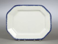 """ca 1860. Octagonal shape with strong, cobalt blue feather edge decoration on a white ware body. Impressed Davenport anchor mark with numerals 5 and 6 on either side of the anchor, indicating a manufacture date of 1856, and an impressed 16 indicating the platter size; 16"""" x 14""""."""