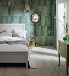 Chameleon Emerald 30x50cm wall & floor tile by British Ceramic Tile (UK). A digitally-printed stone-effect satin ceramic tile. Suitable for light traffic areas such as bathrooms or used here creatively in a bedroom. Chameleon White is used on the floor.