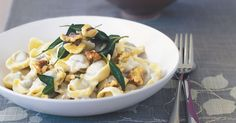 Veal tortellini are made even more special with this creamy blue cheese sauce with crispy sage and walnuts.