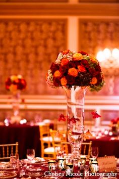 indian wedding reception floral centerpiece red gold http://maharaniweddings.com/gallery/photo/4638