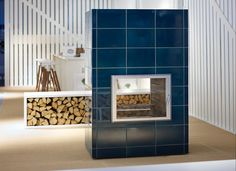 Ksenia fireplace with new petrol blue tiles in the Tulikivi showroom at Habitare Exhibition.