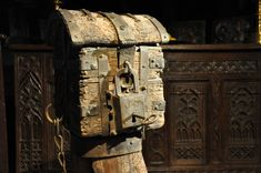 AN EXTREMELY RARE MID 15TH CENTURY ENGLISH OAK AND IRON ALMS BOX. ROCHE ABBEY. CIRCA 1450.