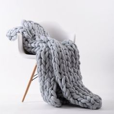 """DESCRIPTION This incredible, hand-knit piece is more than a blanket - it's a work of art and a beautiful addition to your home decor! Available in 3 colors. 40"""" X 60"""" Final Sale 100% merino wool Hypoa"""