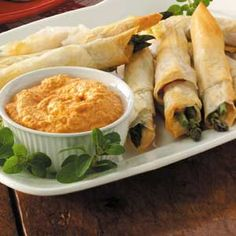 Prosciutto Phyllo Roll-Ups Recipe -These elegant finger foods use delicate phyllo dough. With artichoke sauce on the side, the cheesy rolls make extra-special hors d'oeuvres.