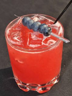 The Eclipse (raspberries, blueberries, tequila, Ginger beer)