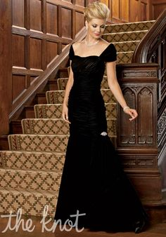 Dress features draping, rhinestone detail, and matching wrap. Also available in petite sizes 0 to 34.