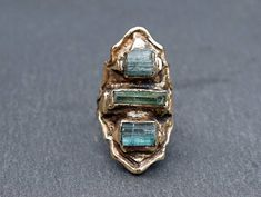 * As seen in Belle Armoire Jewelry!* BYZANTINE Tourmaline Ring Inspired by ancient Byzantine Royalty, this ring is incredibly special. Each ring features lovely raw Tourmaline stones in blue and green. Tourmaline is one of the most beautiful stones and I love pairing them together to