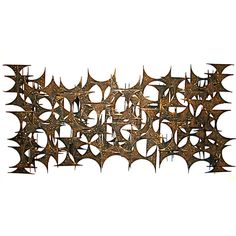 Large Brutalist Wall Sculpture | From a unique collection of antique and modern wall-mounted sculptures at http://www.1stdibs.com/furniture/wall-decorations/wall-mounted-sculptures/
