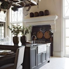 John Jacob Interiors - Kitchen with black island // COUNTRY KITCHEN //⠀ .⠀ Wicker, wood, tile and marble finishes in this mordern take on a country kitchen in our - A beautiful homestead in . Cozy Kitchen, Kitchen Dining, Kitchen Decor, Kitchen Ideas, Kitchen Stove, Interior Design Kitchen, Interior Decorating, Country Kitchen Designs, Kitchen Country