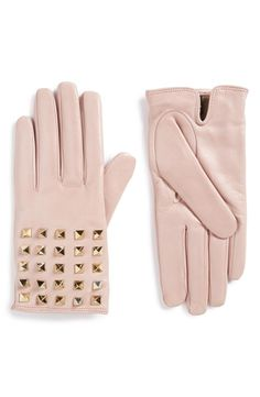 Rows of polished rockstuds pattern the backs of these smooth, refined Italian lambskin-leather gloves fashioned with a soft, cashmere lining.