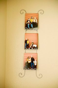 8x10 pics mounted on boards and displayed on a plate rack