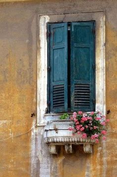 Colors! Why is it that worn color and old shutters in Europe are beautiful, but in this country, it looks run-down???